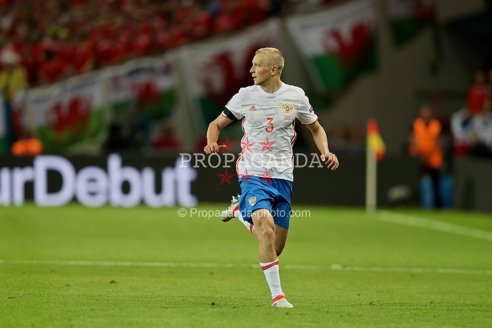 TOULOUSE, FRANCE - Monday, June 20, 2016: Russia's Igor Smolnikov in action against Wales during the final Group B UEFA Euro 2016 Championship match at Stadium de Toulouse. (Pic by David Rawcliffe/Propaganda)