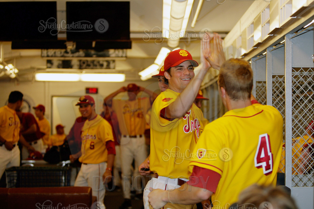 13 March 2011: NCAA Pac-10 college UCLA-USC sports rivalry baseball teams met in a non-conference game at Dodger Stadium as part of the Dodgertown Classic.  USC Trojans defeated the UCLA Bruins 2-0 during an afternoon weekend game inside the MLB stadium.  #4 Joe De Pinto getting a high five from player in the lockerroom after the game.