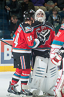 KELOWNA, CANADA - OCTOBER 7: Tyson Baillie #24 congratulates Jackson Whistle #1 of Kelowna Rockets on the win and shut out against the Swift Current Broncos on October 7, 2014 at Prospera Place in Kelowna, British Columbia, Canada.  (Photo by Marissa Baecker/Getty Images)  *** Local Caption *** Tyson Baillie; Jackson Whistle;