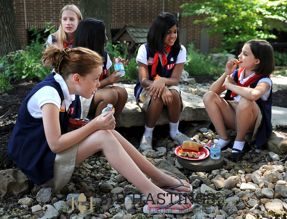 9 JUNE 2012 -- COTTLEVILLE, Mo. -- American Heritage Girls members Annie McLoughlin (front left) Jennifer Jansson (back left), Dania Salman, Amina Islam and Rachel Roberts visit while having lunch following their year-end meeting at St. Joseph Parish in Cottleville, Mo. Saturday, June 9, 2012. Photo © copyright 2012 Sid Hastings.