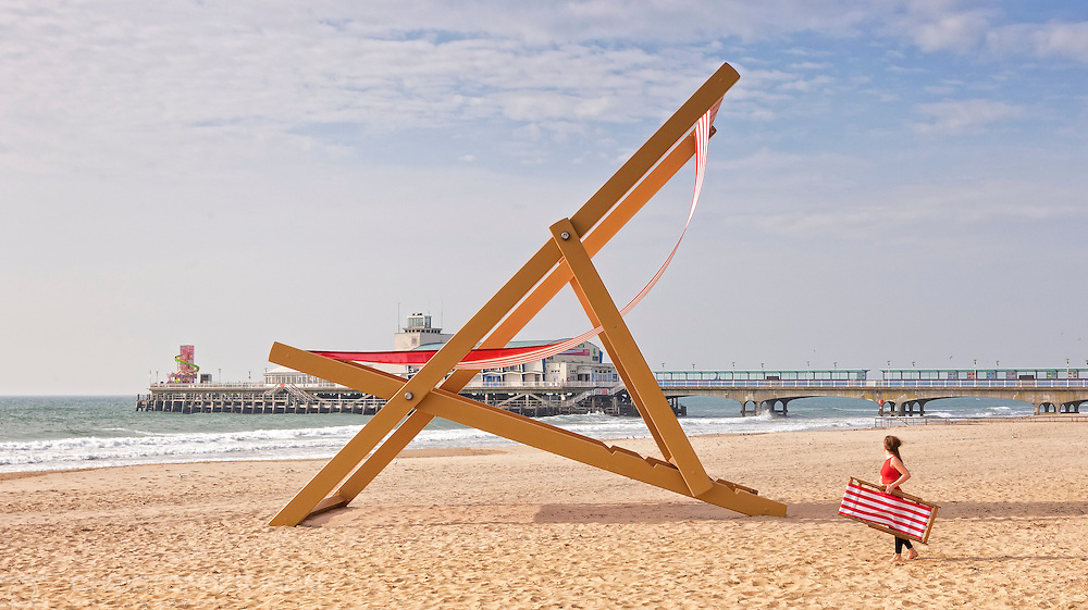A woman looks up at the world's largest deckchair on Bournemouth Beach. The giant chair was built by sculptor Stuart Murdoch, weighs almost six tonnes and measures eight and a half metres tall.