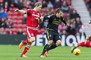 Nottingham Forest midfielder Ben Osborn (38) under pressure from Middlesbrough FC midfielder Grant Leadbitter (7) during the Sky Bet Championship match between Middlesbrough and Nottingham Forest at the Riverside Stadium, Middlesbrough, England on 23 January 2016. Photo by George Ledger.