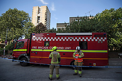 © Licensed to London News Pictures. 23/08/2019. London, UK. Emergency services at the scene where a fire has started at a flat in a tower block at Darfield Way in west London, just yards from Grenfell Tower. Photo credit: Ben Cawthra/LNP