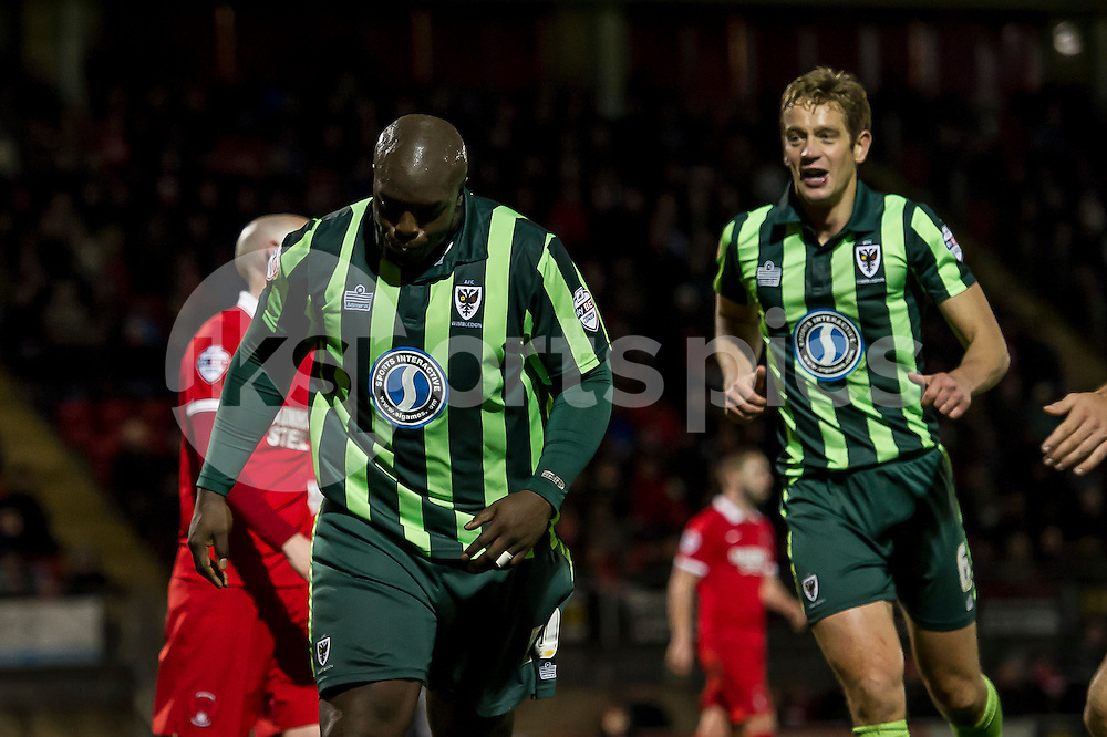 Adebayo Akinfenwa of Wimbledon celebrates his goal to make it 1-1 during the Sky Bet League 2 match between Leyton Orient and AFC Wimbledon at the Matchroom Stadium, London, England on 28 November 2015. Photo by Salvio Calabrese.