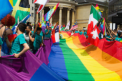 London, July 8th 2017. Thousands of LGBT+ revellers take part in the annual Pride in London parade under the banner #LoveHappensHere. PICTURED: A giant pride flag is unfurled on Regent Street.