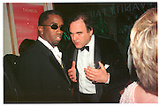 Sean 'Puff Daddy' Combs & Oliver Stone at the Vanity Fair Oscar  night party, Mortons, Los Angeles. 23 March 1988. Film 98174f27<br /> Copyright Photograph by Dafydd Jones<br /> 66 Stockwell Park Rd. London SW9 0DA<br /> Tel. 0171 733 0108