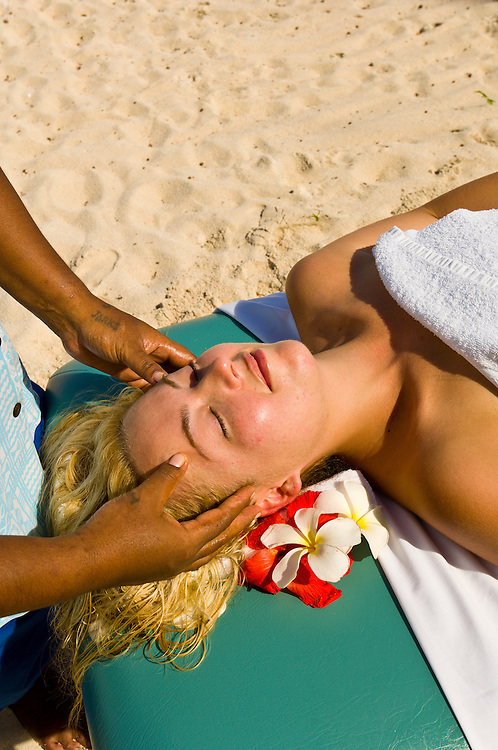 Woman getting a massage on the beach, Vatulele Island Resort, Fiji Islands
