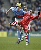Photo: Aidan Ellis.<br /> Manchester City v Charlton Athletic. The Barclays Premiership. 12/02/2006.<br /> City's Richard Dunne beats Charlton's JErome Thomas to the ball