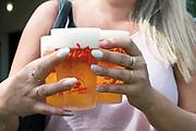 woman hands carrying beer