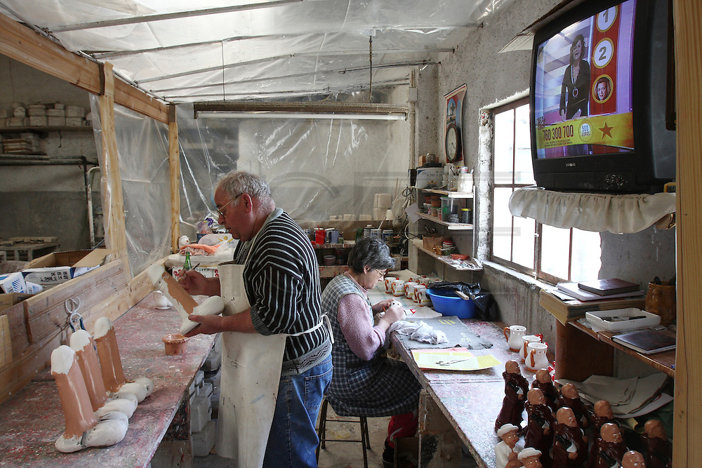 Francisco Silva and his wife working on their  erotic ceramic atelier at Chao da Parada, in Caldas da Rainha city. He is one of the last artisans of this kind of erotic pottery traditional to Caldas da Rainha, in the center region of Portugal.