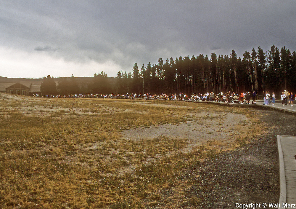 Lined up waiting for Old FAITHFUL to erupt, Yellowstone National Park, Wyoming.  It started raining about an hour later.