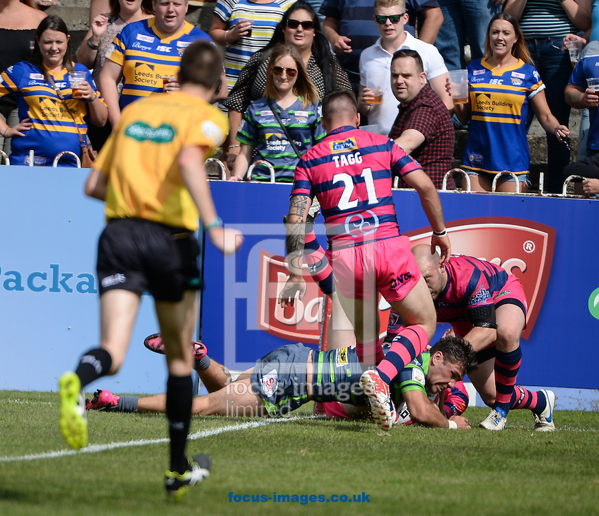 Joel Moon of Leeds Rhinos dives over to score  during the Super 8s Qualifiers match at The Big Fellas Stadium, Post Office Road, Pontefract.<br /> Picture by Richard Land/Focus Images Ltd +44 7713 507003<br /> 06/08/2016