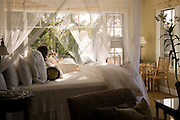 Milliken Creek Inn, a bed and breakfast inn on the Napa River in Napa, California. Napa Valley. Room number 2 looking south on a bend in the Napa River. MODEL RELEASED.
