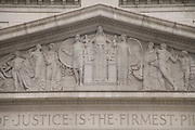 close up of the frieze above the entrance to court house in New York City