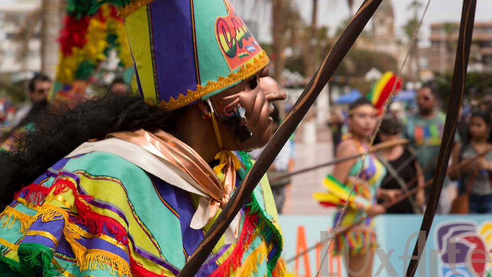 Dancers, musicians, spectators and atmosphere at the Carnaval in Arica held annually for the past 5 years in Arica, Chile.