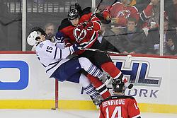 Nov 2; Newark, NJ, USA; New Jersey Devils defenseman Anton Volchenkov (28) hits Toronto Maple Leafs center Matthew Lombardi (15) during the first period at the Prudential Center.