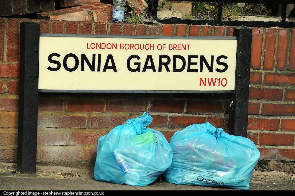© Licensed to London News Pictures. 23/09/2011. LONDON, UK. The Sonia Gardens street sign. Six people, including three children, two teenagers and an adult have died following a house fire in Neasden, North West London today (24 Sept 2011). Emergency services were called tot he blaze in the early hours of the morning. Photo credit:  Stephen Simpson/LNP