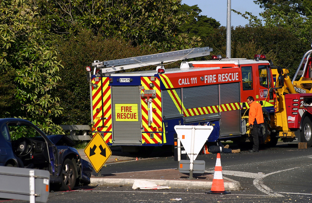 Emergency services at the scene of a collision between a fire appliance on a call out and a car carrying four passengers with one person seriously injured, Pukekohe, New Zealand, Saturday, October 26, 2013. Credit:SNPA / Grahame Clark