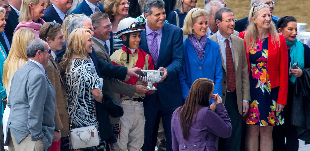 """Unified"", as yet undefeated, wins the Peter Pan"", with Jose Ortiz aboard. In the winner's circle getting the trophy. May 14, Belmont Park."