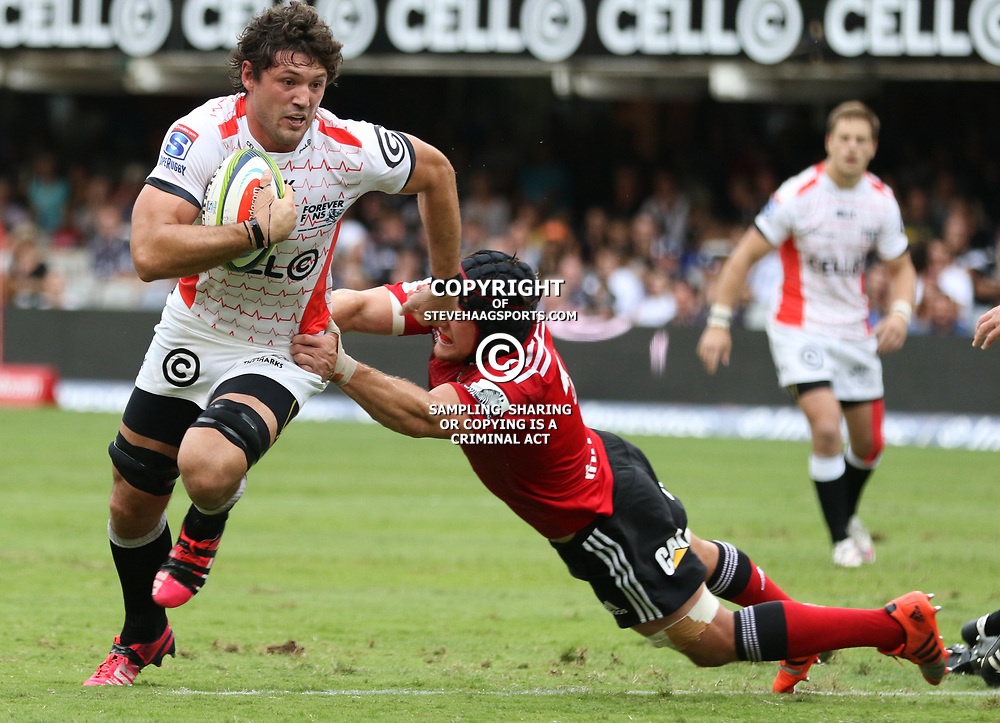 DURBAN, SOUTH AFRICA - APRIL 04: Matt Todd of the Crusaders looks to tackle  Ryan Kankowski of the Cell C Sharks during the Super Rugby match between Cell C Sharks and Crusaders at Growthpoint Kings Park on April 04, 2015 in Durban, South Africa. (Photo by Steve Haag/Gallo Images)