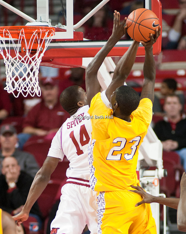 Dec 15, 2012; Fayetteville, AR, USA; Alcorn State Braves forward Josh Nicholas (23) takes a shot against Arkansas Razorbacks guard Davion Spivey (14) during a game at Bud Walton Arena.  Arkansas defeated Alcorn State 97-59. Mandatory Credit: Beth Hall-USA TODAY Sports