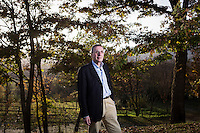 SOVERIA MANNELLI, ITALY - 17 NOVEMBER 2016: Mario Caliguri, 56, mayor of Soveria Mannelli for five mandates and now a University professor, poses for a portrait in Soveria Mannelli, Italy, on November 17th 2016.<br /> <br /> Soveria Mannelli is a mountain-top village in the southern region of Calabria that counts 3,070 inhabitants. The town was a strategic outpost until the 1970s, when the main artery road from Naples area to Italy's south-western tip, Reggio Calabria went through the town. But once the government started building a motorway miles away, it was cut out from the fastest communications and from the most ambitious plans to develop Italy's South. Instead of despairing, residents benefited of the geographical disadvantage to keep away the mafia infiltrations, and started creating solid businesses thanks to its administrative stability, its forward-thinking mayors and a vibrant entrepreneurship numbering a national, medium-sized publishing house, a leading school furniture manufacturer and an ancient woolen mill.