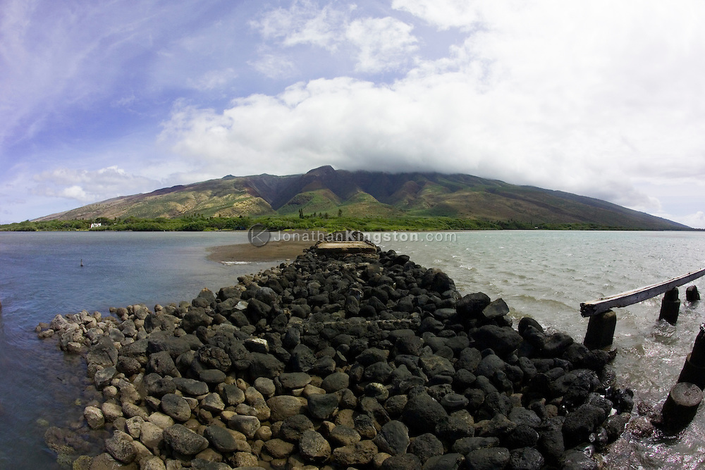 MOLOKAI, HI - A view of the jetty, ocean and land from Kamalo Warf on the island of Molokai.