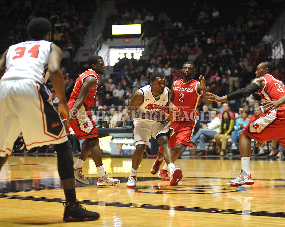 "Ole Miss' Nick Williams (20) vs. Rutgers' Dane Miller (2) at the C.M. ""Tad"" Smith Coliseum in Oxford, Miss. on Saturday, December 1, 2012. (AP Photo/Oxford Eagle, Bruce Newman).."