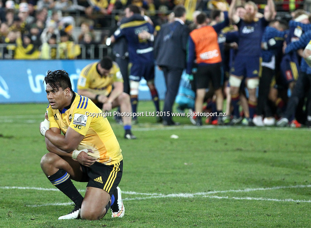 A dejected Julian Savea as the Highlanders celebrate during the Super Rugby Final, Hurricanes v Highlanders. Westpac Stadium, Wellington, New Zealand. 4 July 2015. Copyright Photo.: Grant Down / www.photosport.nz