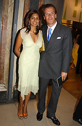 JOEL CADBURY and DIVIA LALVANI at the Royal Academy of Arts Summer Exhibition Preview Party held at Burlington House, Piccadilly, London on 2nd June 2005<br />