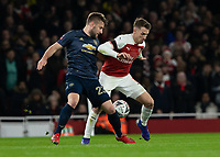 Football - 2018 / 2019 FA Cup - Fourth Round: Arsenal vs. Manchester United <br /> <br /> Luke Shaw (Manchester United) and Aaron Ramsey (Arsenal FC) at The Emirates Stadium.<br /> <br /> COLORSPORT/DANIEL BEARHAM