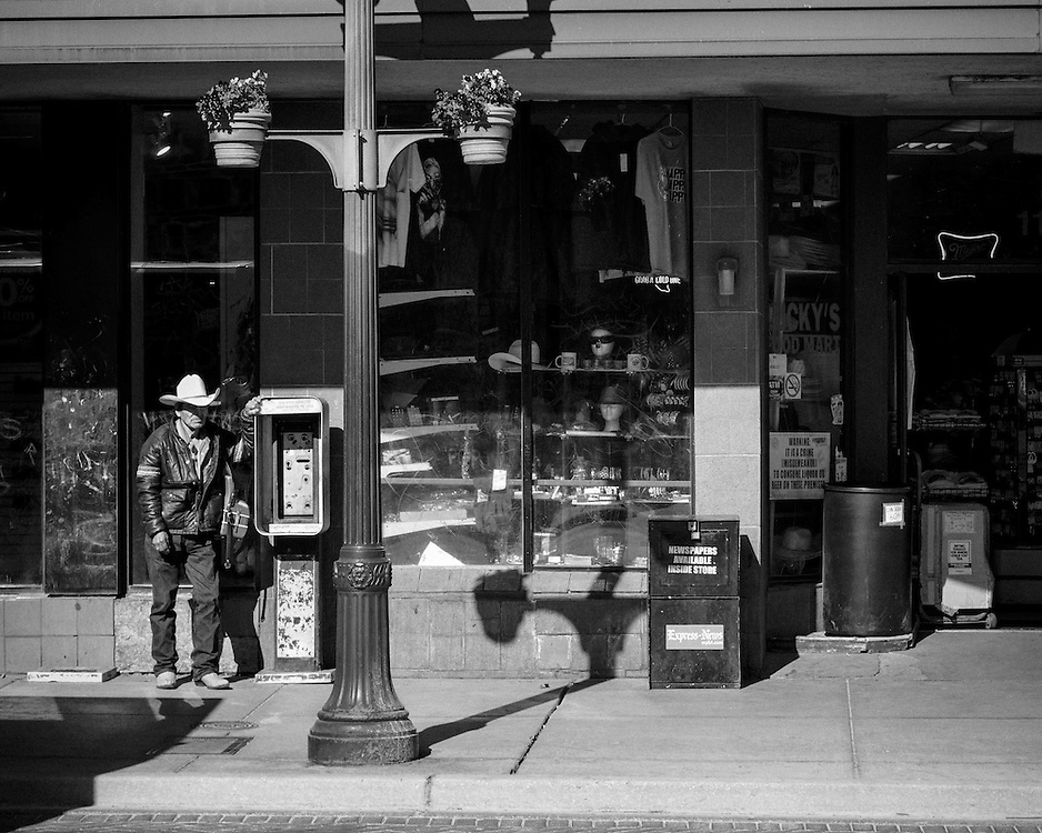 A Caballero leaning against an old pay phone box, taking a quick siesta. <br />