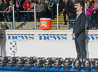 KELOWNA, CANADA - SEPTEMBER 25: Brad Ralph, head coach of the Kelowna Rockets stands on the bench during the national anthem of the season home opener against the Kamloops Blazers on September 25, 2015 at Prospera Place in Kelowna, British Columbia, Canada.  (Photo by Marissa Baecker/Shoot the Breeze)  *** Local Caption *** Brad Ralph;