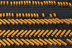 North America, United States, Washington,  Seattle, aerial view of school buses in parking lot