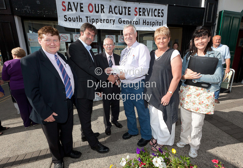 "5/8/2010.The South Tipperary Branch of IMPACT trade union made a donation of EUR5,000 on behalf of its members to the campaign to save South Tipperary General Hospital. Ben Grogan, IMPACT branch chairman, presented a donation cheque to independent Councillor Seamus Healy at the Save the Hospital campaign office on O'Connell Street, Clonmel this evening (Wednesday)...Mr. Grogan said that the union branch decided to make the donation in response to the Government's threat to remove acute services from South Tipperary General Hospital. He said that the hospital provided a much needed service to people in the region, and IMPACT members in health and in local government are determined to defend it in solidarity with the entire population of the region...Mr Grogan explained, ""Only three years ago, Minister Harney opened our hospital following an injection of EUR45 million to bring it to the excellent standard of care which it provides to the wide hinterland of North and South Tipperary, North Cork, West Waterford and East Limerick.  It defies belief that, following that massive investment that the Government would now consider effectively closing the hospital.""..Pictured at the presentation was from left Walter Hennessy, vice chairperson IMPACT South Tipperary Branch; Cllr Pat English, treasurer Save Our Hospital committee, Cllr Seamus Healy, Save Our Hospital committe; Ben Grogan, chairperson, IMPACT South Tipperary branch; Cllr Gabrielle Egan, secretary Save Our Hospital committee and Deirdre Whelan, treasurer IMPACT South Tipperary branch..Picture Dylan Vaughan."