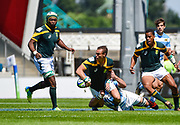 South Africa full-back Curwin Bosch looks to of-load the ball during the World Rugby U20 Championship 3rd Place play-off  match Argentina U20 -V- South Africa U20 at The AJ Bell Stadium, Salford, Greater Manchester, England on Saturday, June 25, 2016.(Steve Flynn/Image of Sport)