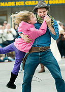 PRICE CHAMBERS / NEWS&amp;GUIDE<br /> Brock Harris scoops up audience member Kay Tollison for a dance at the Jackson Hole Shootout on Saturday. The Jackson tradition continues all summer, Monday through Saturday at 6 p.m.