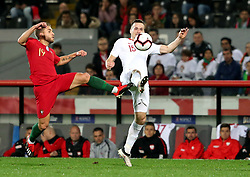 LISBON, Nov. 21, 2018  Kevin Rodrigues (L) of Portugal vies with Tomasz Kedziora of Poland during the UEFA Nations League soccer match League A Group 3 in Guimaraes, Portugal on Nov. 20, 2018. The match ended with a 1-1 tie. (Credit Image: © Catarina Morais/Xinhua via ZUMA Wire)