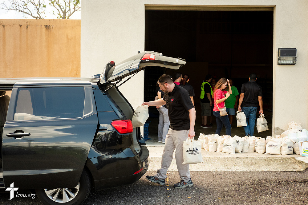 The Rev. Michael Meyer, manager of LCMS Disaster Response, unloads bags of food and supplies for distribution to residents at a local community center on Tuesday, April 17, 2018 in Mayagüez, Puerto Rico. LCMS Communications/Erik M. Lunsford