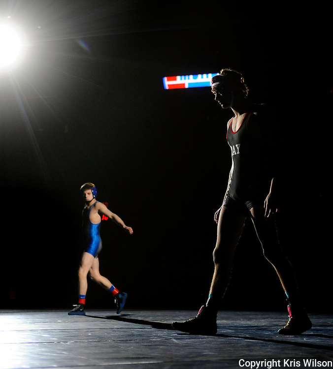 Jefferson City's Hunter Neighbors, right, and Seckman's Brock Wingbermuehle pace the mat during wrestler introductions just before the start of the Class 4 120-pound championship match during the 2012 MSHSAA Wrestling Championships at Mizzou Arena in Columbia, Mo.
