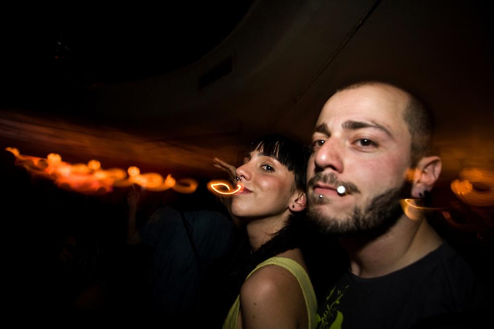 """5:38 AM: Ángela Hermosa, 23, and Marco Fiordalisi, 26, dane together at """"Ocho y Medio"""", in Madrid.."""