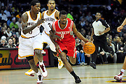 Feb. 23, 2011; Cleveland, OH, USA; Houston Rockets point guard Aaron Brooks (0) drives past Cleveland Cavaliers guard Manny Harris (6) during the third quarter at Quicken Loans Arena. The Rockets beat the Cavaliers 124-119. Mandatory Credit: Jason Miller-US PRESSWIRE