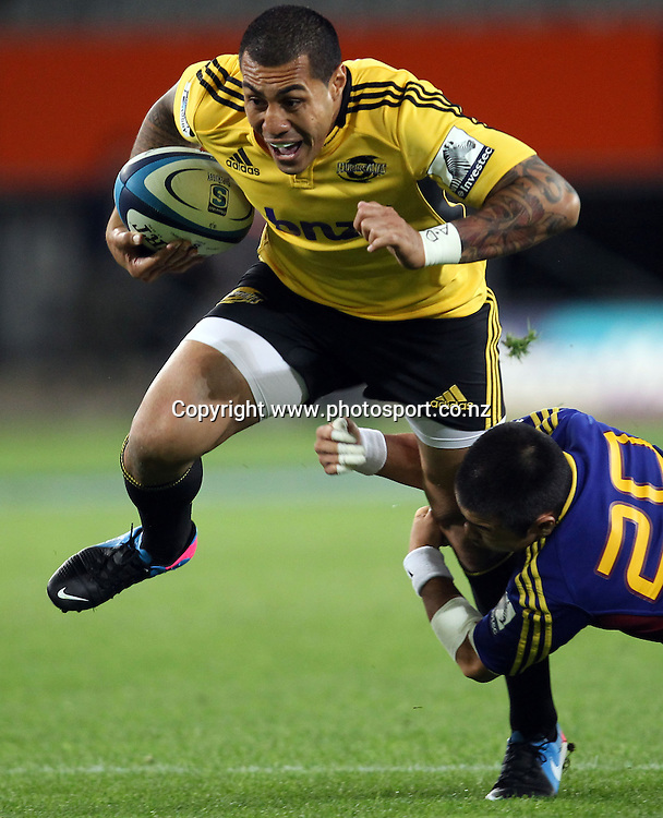 Tusi Pisi of the Hurricanes on the charge.<br /> Super Rugby - Highlanders v Hurricanes, 15 March 2013, Forsyth Barr Stadium, Dunedin, New Zealand.<br /> Photo: Rob Jefferies / photosport.co.nz
