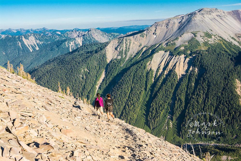 "Women hiking on the Sunrise Rim Trail in the ""Sunrise"" section of Mt. Rainier National Park, Washington, USA"