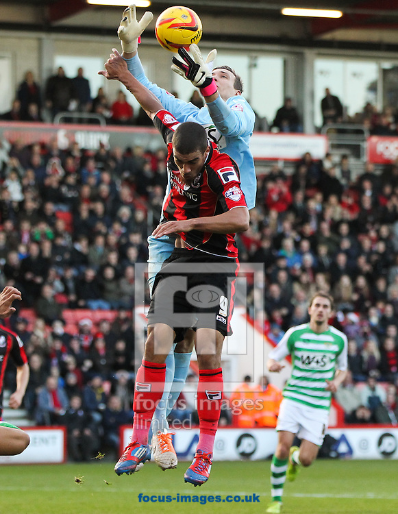 Picture by Tom Smith/Focus Images Ltd 07545141164<br /> 26/12/2013<br /> Lewis Grabban (front centre) of Bournemouth is beaten to the ball by Marek Štēch (back centre) of Yeovil Town during the Sky Bet Championship match at the Goldsands Stadium, Bournemouth.