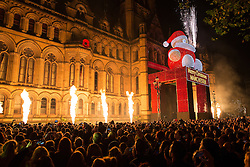 © Licensed to London News Pictures . 07/11/2015 . Manchester , UK . Crowd watching fireworks at the Christmas lights switch on at Albert Square in front of Manchester Town Hall . Photo credit : Joel Goodman/LNP
