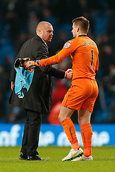 Burnley Manager Sean Dyche congratulates Galkeeper Thomas Heaton after the match ends in a 2-2 draw - Photo mandatory by-line: Rogan Thomson/JMP - 07966 386802 - 28/12/2014 - SPORT - FOOTBALL - Manchester, England - Etihad Stadium - Manchester City v Burnley - Barclays Premier League.