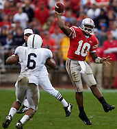 MORNING JOURNAL/DAVID RICHARD.Quarterback Troy Smith completes a first down pass to split end Anthony Gonzalez.