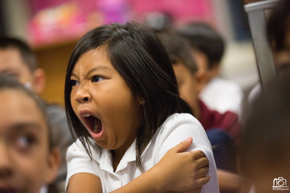 Third grader Ashlyn Morales yawns during the first day of school in Laura Polden's class at Zanker Elementary School in Milpitas, California, on August 19, 2013. (Stan Olszewski/SOSKIphoto)