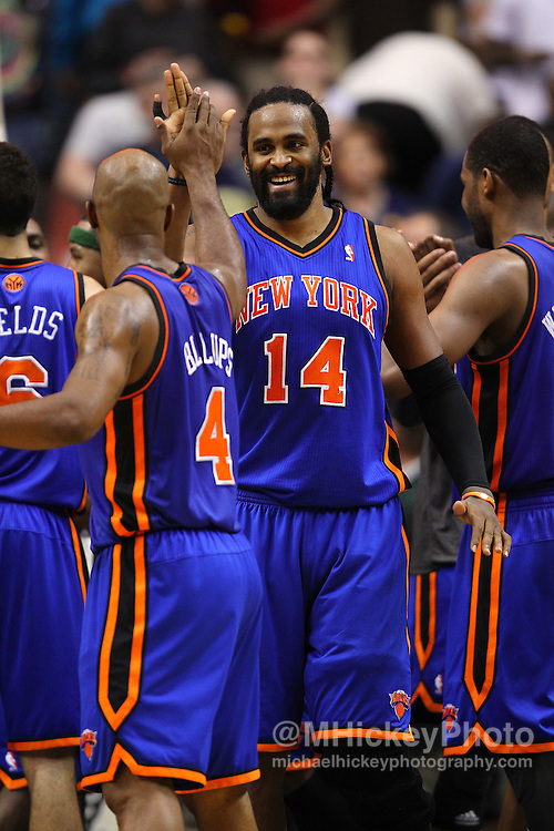 April 10, 2011; Indianapolis, IN, USA; New York Knicks center Ronny Turiaf (14) congratulates New York Knicks point guard Chauncey Billups (4) at Conseco Fieldhouse. New York defeated Indiana 110-109. Mandatory credit: Michael Hickey-US PRESSWIRE